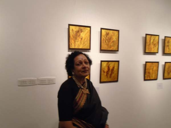 Artist and Poet Kusum Shukla with her The Majestic Tiger Series of art works